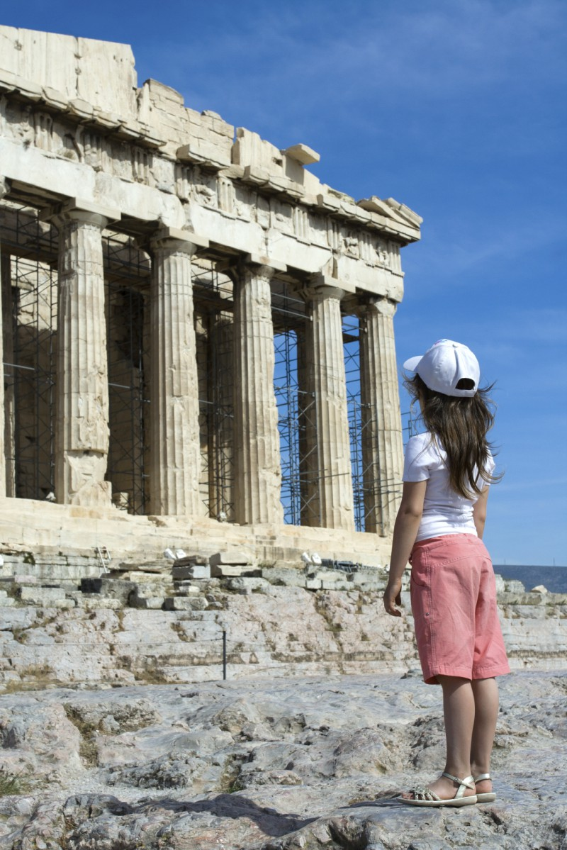Child in front of Ancient Parthenon in Acropolis Athens Greece