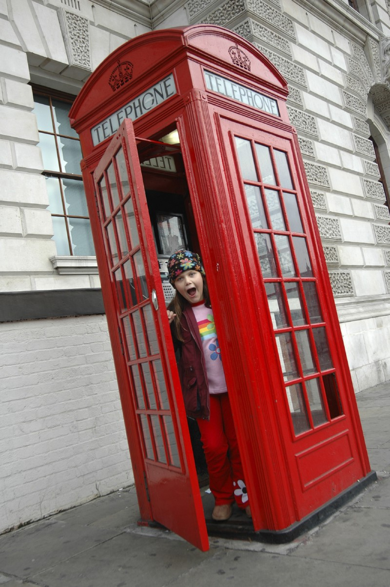 Girl in London telephone booth